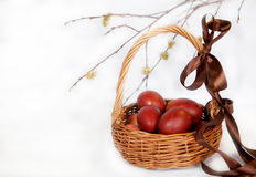 Colored eggs in the basket. On the traditions of the Orthodox Easter Stock Photo