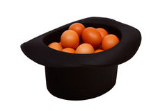 Colored eggs in a black hat Stock Images