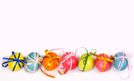 Colored eggs with bows royalty free stock images