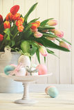 Colored eggs with bows with tulips Stock Images