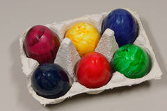 Colored eggs in a box. Six colored eggs in a box - egg tray royalty free stock images