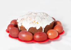 Colored eggs and cake Royalty Free Stock Images