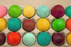 Colored eggs in carton. Closeup of brightly colored or dyed eggs in a carton Royalty Free Stock Photo
