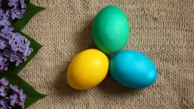Colored eggs different colors with beautiful flowers, old style background stock footage