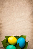 Colored eggs different colors on old style background with copy space Stock Photo