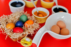 Colored eggs for Easter in bowls Stock Photo