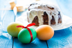 Colored eggs on easter cake background Stock Photo