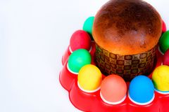 Colored eggs and Easter cake on white background Stock Photos