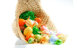 Colored eggs in hat Stock Photography