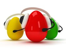 Colored eggs with headsets  over white Stock Photography
