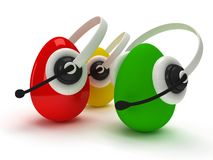 Colored eggs with headsets  over white Royalty Free Stock Images