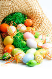 Colored Eggs In A Hay Hat Royalty Free Stock Image
