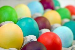 Colored Eggs In Carton Stock Image