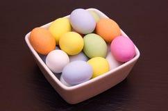 Colored eggs inside bowl on slate Stock Image