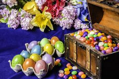 Colored Eggs Jelly Beans and Spring Flowers Royalty Free Stock Images