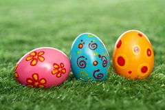 Colored eggs on lawn Stock Photography