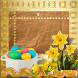 Colored eggs and narcissus to celebrate Easter Royalty Free Stock Photos