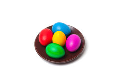 Colored eggs on a plate. Royalty Free Stock Image