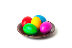 Colored eggs on a plate. Stock Image