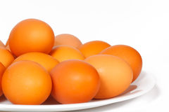 Colored eggs on a plate Stock Photography