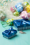 Colored eggs and presents in blue boxes Stock Image