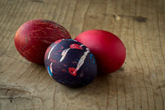 Colored eggs on wooden table Royalty Free Stock Photos