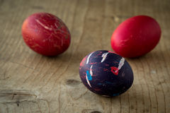 Colored eggs on wooden table Royalty Free Stock Photography