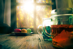 Colored eggs wooden table rural hut Stock Photo