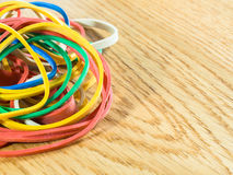 Colored elastic bands on wooden background royalty free stock images