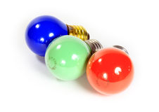 Colored electric bulbs. Three of different colors electric bulbs Stock Images