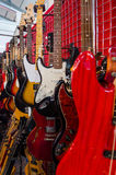 Colored electric guitars. Hanging on the wall Stock Photography