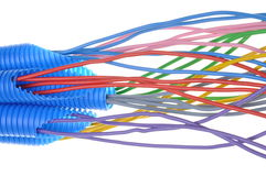 Colored electrical copper cables for electrician in corrugated pipes Royalty Free Stock Photos