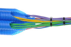 Colored electrical copper cables for electrician in corrugated pipes Royalty Free Stock Images