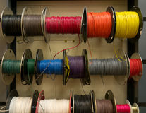 Free Colored Electrical Wires On Spools On Rack Stock Image - 25129441