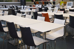 Colored empty tables and chairs Royalty Free Stock Image