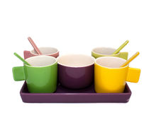 Colored Espresso Coffee Cup Set on White. A brightly colored matching set of espresso cups, bowl, tray and stir sticks on a white background royalty free stock photos