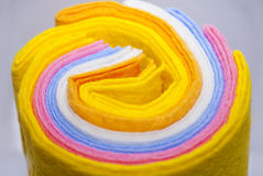 Colored fabric. Many colored viscose fabric in roll Stock Image