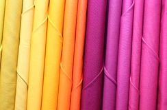 Colored fabric on sale. Orange and colored fabric on sale in the textile shop Royalty Free Stock Photo