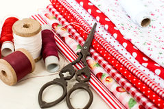 Colored fabric spools of thread and scissors for sewing Stock Image