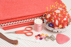 Colored fabric, thread and other sewing tools. Royalty Free Stock Images