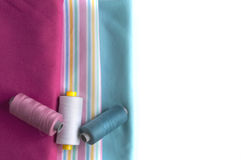 Colored fabrics with appropriate spool of thread Royalty Free Stock Image