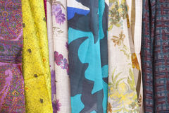 Colored fabrics. As a background Royalty Free Stock Photos