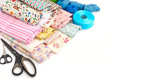 Colored fabrics for crafts, art projects. Materials for creativity, a bright cloth, the tape, scissors. White background. Everything for handmade Stock Photo