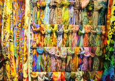 Colored fabrics. A lot of colorful shawls and scarves Royalty Free Stock Photo