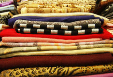 Colored fabrics. Stack of folded colored tissue Stock Photos