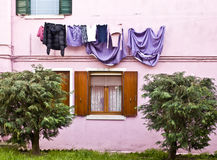 Colored facade in Burano with laundry hanging in the sun Stock Images
