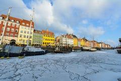 Colored facades of Nyhavn in Copenhagen in Denmark in winter stock image