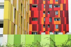 Colored facades and walls of modern buildings. Walls and windows in yellow, green and red. colorful facades of modern buildings Stock Images