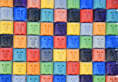 Colored faces. Multiple faces with the same expression Royalty Free Stock Images