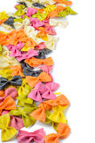 Colored farfalle pasta, on the left edge Royalty Free Stock Images